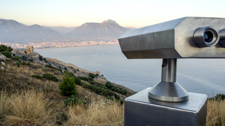 Coin Operated Binocular viewer next to the waterside promenade in Antalya the Bay and city. Observation deck - binocular with  telescope Turkey. Concept of travel and tourism. Beautiful panorama 写真素材
