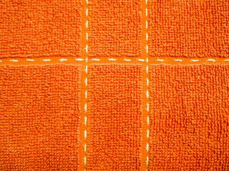orange natural cotton towel background, closeup photo texture. Vintage white and blue towel texture - snow cover imitation for background or text box. Toweling material