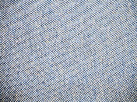 Weaved texture of a material. Linen natural grey fabric, square pattern, close up. Silk pattern. Cotton weft or white yarn. Abstract texture. Vintage background of blue and white elements