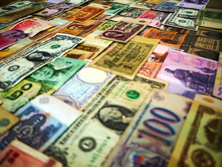 Real international banknotes from world major countries. financial economy background for desktop wallpaper. Money Texture. lots wads of money cash. The concept of wealth, profits, business, finance. Archivio Fotografico