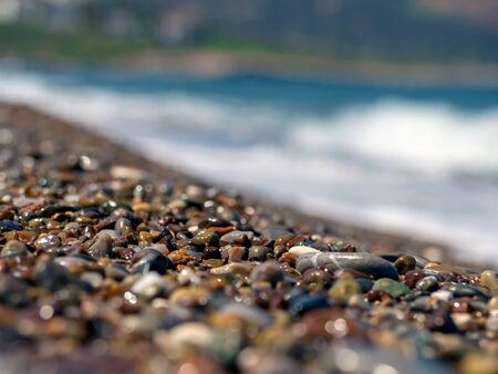 Pattern with turquoise sea stones beach on for design. Beautiful gravel background. Stone texture. Horizon sea water landscape. Image For desktop, wallpapers, banner. Copy space, selective focus 스톡 콘텐츠