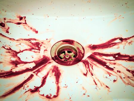 Blood stains in bathroom, white ceramic sink. Bleeding, criminal and suicide concept. Splashes Of Blood. Fresh Vibrant Blood Splat. Copy space, horror themed concepts and Hemophobia