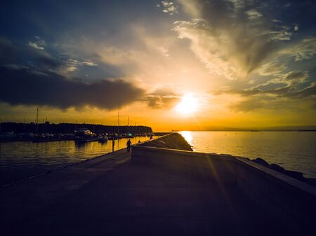 Baltic sea bay at Colorful sunset in golden and brown tones. Tallinn , Estonia. Popular touristic destination. Stock Photo