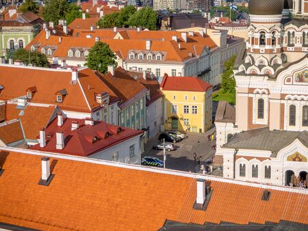 Many red roofs od old Tallinn city. Estonia. Aerial top view of the old town in summer. Historical part of town with view from Tall Hermann observation platform