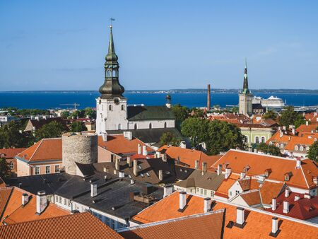 The bell tower of St. Nicholas  Church. Tallinn city. Estonia. Aerial top view of the old town in summer. Historical part of town with view from Tall Hermann observation platform to the Old Talllinn