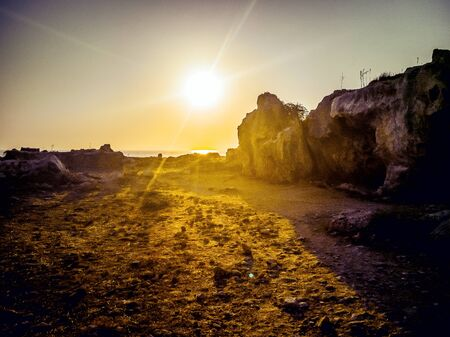 Paphos Archaeological Park. Sunset in Paphos Archaeological Park, Republic of Cyprus. View of the ancient ruins at Faros Beach. at sunset. Copy space. Filtered image 版權商用圖片