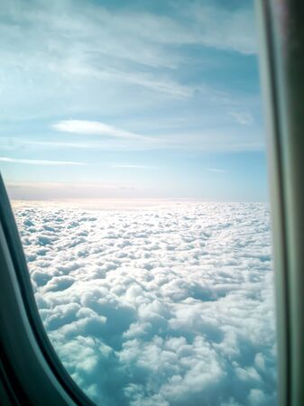 Clouds and sky as seen through window of an aircraft. Picture of plane in the blue sky panorama. Abstract background with copy space. image for desktop, background, wallpaper Фото со стока