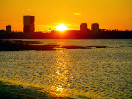 downtown buildings silhouettes. Nature Orange sea sunset in the city landscape beautiful landscape of Tallinn skyline Panoramic view on the beach. Estonia