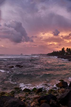 Fishermen in Sri Lanka fishing at sunset. Indian Ocean. Sri-lanka