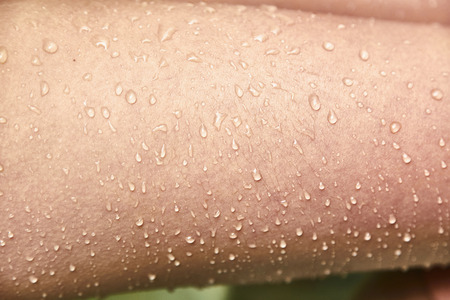 Goosebumps and drops of water on the female skin. Close-up. Goosebumps from the cold. 写真素材