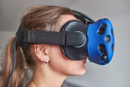 The girl in the glasses of virtual reality. Stock fotó