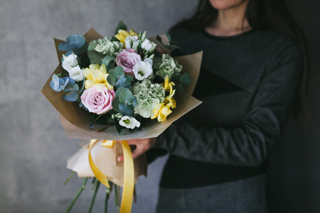 Beautiful bouquet of flowers in the hands of a woman.