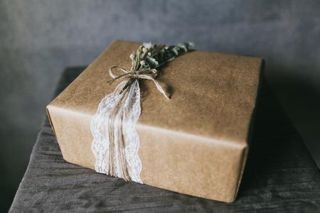 Beautiful handmade gift box with lace ribbon. 写真素材 - 124716590