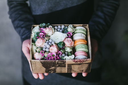 Multicolored handmade macarons in a gift box.