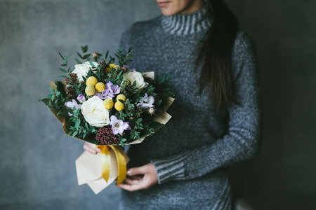 Beautiful bouquet of flowers in the hands of a woman. 写真素材 - 124716851