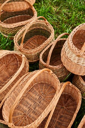 Collection of brown handmade rattan baskets for harvesting.