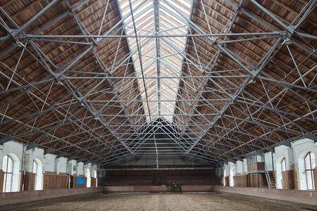 Wooden roof in the hangar for horses Foto de archivo - 129171171