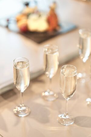 Glass goblets with champagne. wedding ceremony, new year.