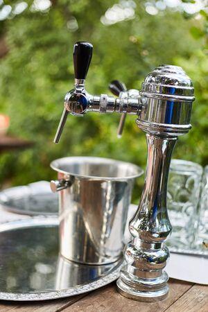 Silver beer dispenser close up. Liquid dispenser. Фото со стока