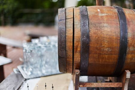 Wooden barrel for draft drinks close up.