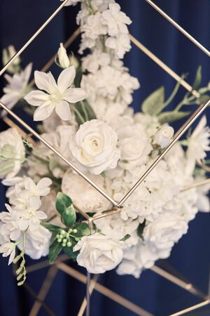 Wedding decor with white flowers and candles. Table decoration. Wedding celebration. Banquet in the restaurant. Wedding organisation Stock Photo