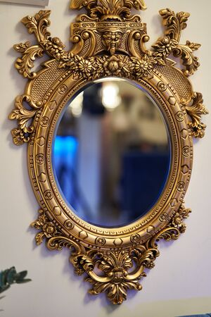 Old carved round mirror with gilding. Stok Fotoğraf