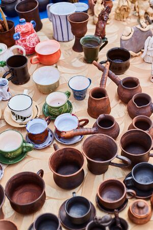 Handmade pottery. Clay dishes close up. Handicraft Exhibition.