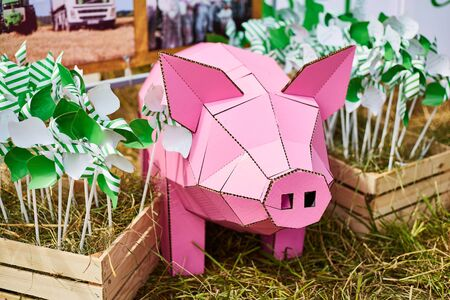 Scenery pink pig. Decor for the garden. Agricultural exhibition.