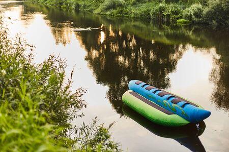 Banana boat on a small river at sunset.