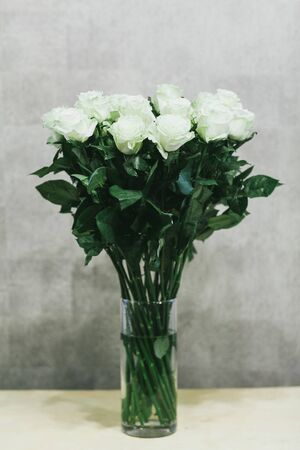 A bouquet of large white roses close up.