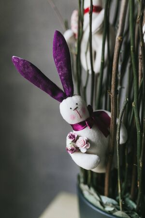 Handmade toy hare. Cute childrens toy closeup. Reklamní fotografie