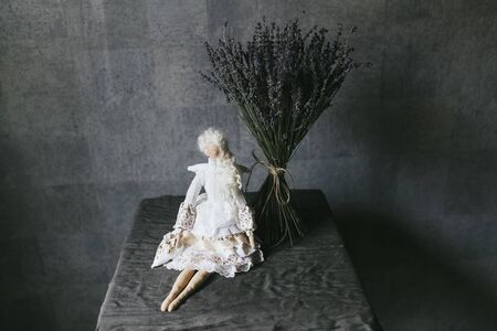 Small elegant handmade doll close up.