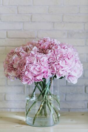 Bouquet of delicate pink flowers close up. Hortensia. Stock Photo