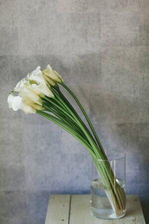 A bouquet of white callas close up.