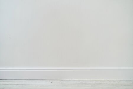 Empty room with white cement wall texture and white wooden floor pattern Standard-Bild - 134731754