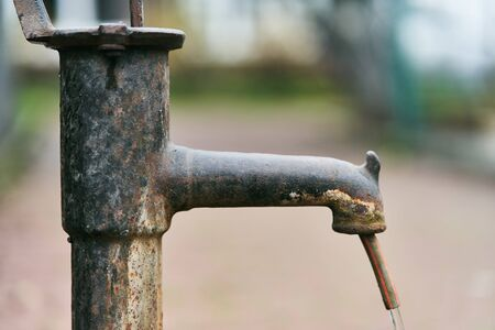 Close up of an old-style column with drinking water in an autumn park, selective focus Stock fotó