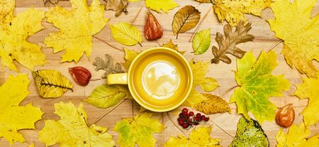 Autumn flat lay composition with dry leaves wreath frame and empty mug on a wooden background. Creative autumn. Top view, copy space