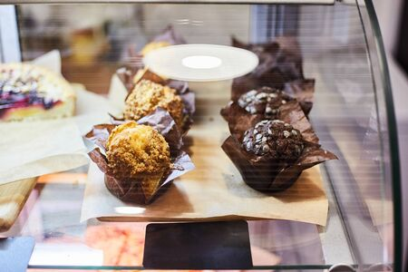 Muffins in a shop window of a pastry shop. Close-up