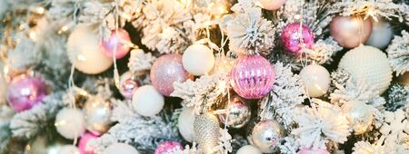 Christmas tree with New Year s balls and a garland. Copy text.