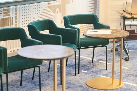 Upholstered chairs and round tables in the conference room. Stock Photo