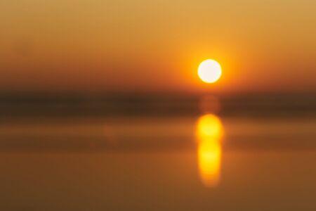 India, North Goa. Beautiful Sunset at Arambol Beach. Blurred image. Banner. Copy text.