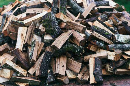 Chopped logs for a bath furnace. Logs for kindling a fire. Imagens