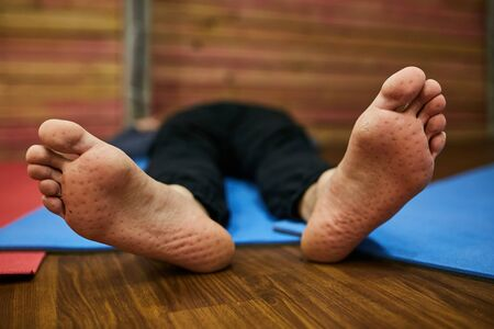 Feet of a man close-up after standing on nails. Imagens