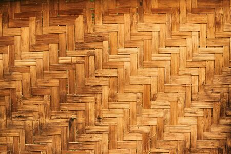 The bamboo texture of a traditional fan.Wickerwork bamboo texture background. Imagens