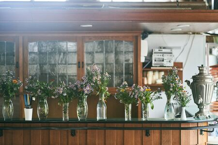 Fresh Flowers in vases at the bar.