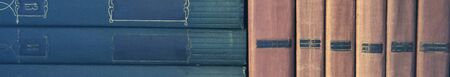 A row of Old Books on a shelf. Close-up. Banner Imagens