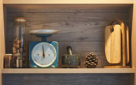 Kitchen shelf with scales, chopping boards. Cooking Tools. Imagens