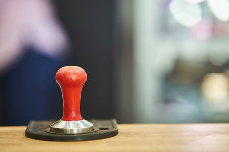 Tamper for making coffee. Barista tool used to form the right coffee pill. Imagens