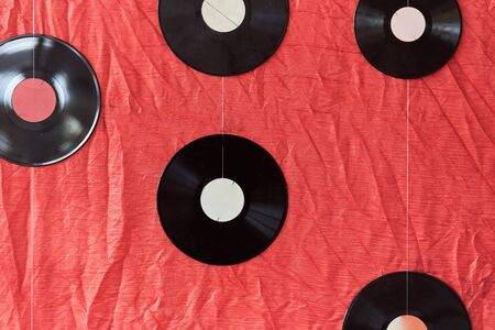 Many vinyl records on a red background Banco de Imagens