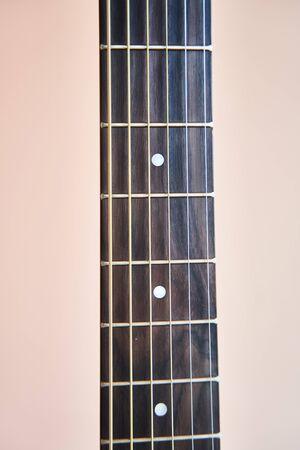Guitar fretboard. Banner. Close-up. Vulture of an acoustic guitar. 免版税图像